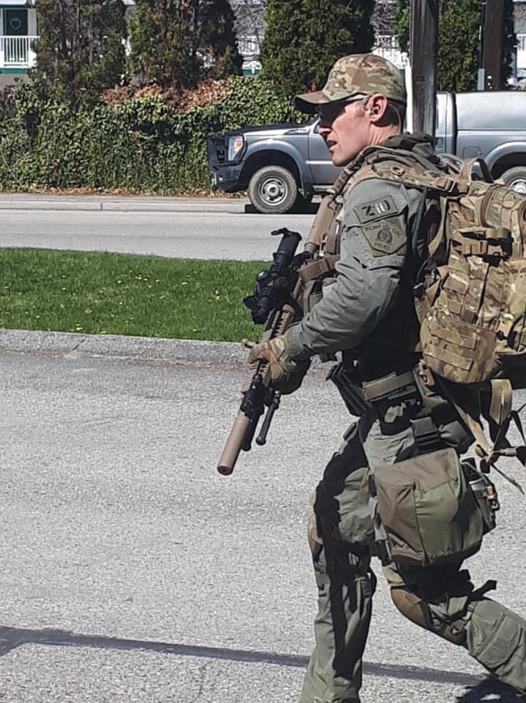<who> Photo credit: Michael Miller </who> Police near the Empire Motel in Penticton
